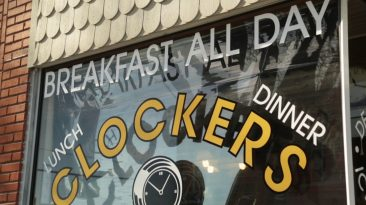 "Clockers restaurant window with text that reads, ""Breakfast all day, lunch, dinner"""