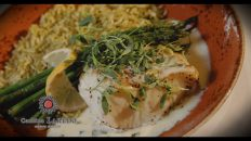 A plate of grilled fish, asparagus, and rice from Cantina Laredo